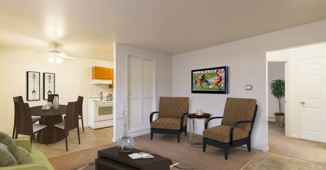 Bright, spacious Living Room at Penfield Village Apartments in Penfield, New York