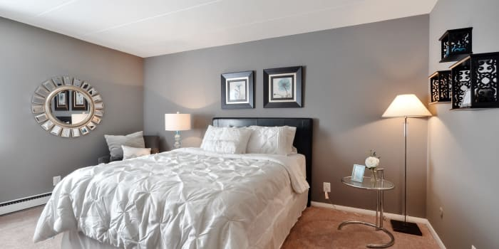 Elegantly decorated bedroom at William Penn Village Apartment Homes in New Castle, DE