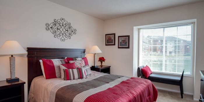 Bedroom with elegant finishes at Hidden Lakes Apartment Homes in Miamisburg, OH