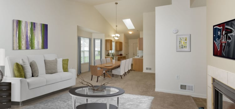 Living and dining room at Villas of Victor and Regency Townhomes in Victor, New York