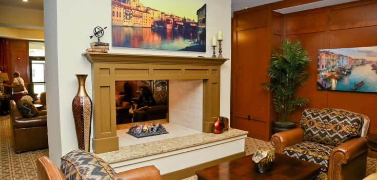 Fireplace and comfortable seating at Merrill Gardens at Solivita Marketplace