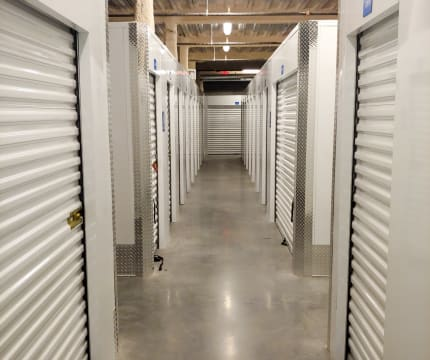 StorQuest Self Storage well lit hallway in Miami, Florida