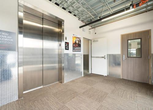 Lobby with elevator at StorQuest Self Storage in Vista, California