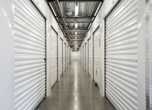 A hall of storage units of StorQuest Self Storage in Vista, California
