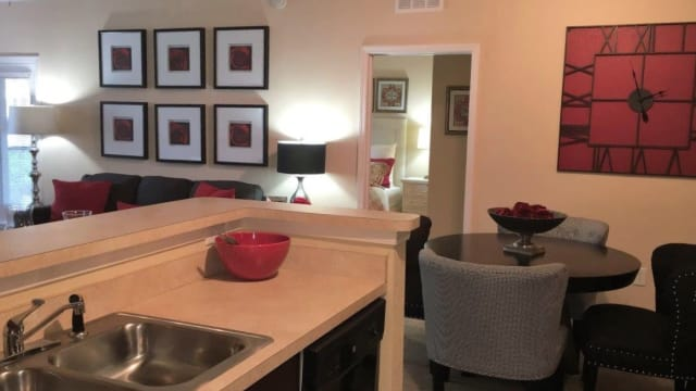 Kitchen and dining table at Integra Landings in Orange City, FL