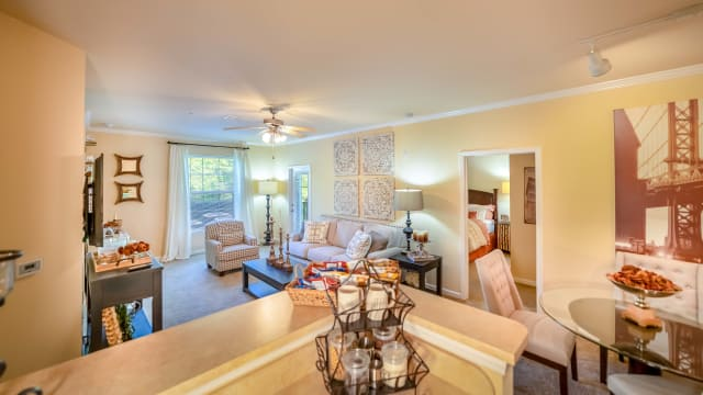 Apartments with a living room at Integra Woods in Palm Coast, Florida