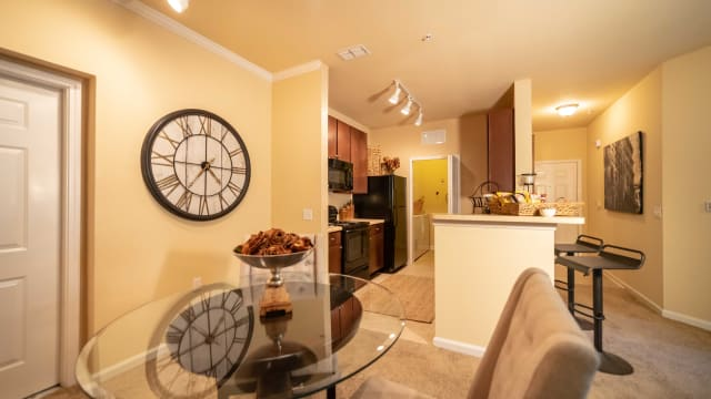 Dining room and kitchen view at Integra Woods in Palm Coast, Florida