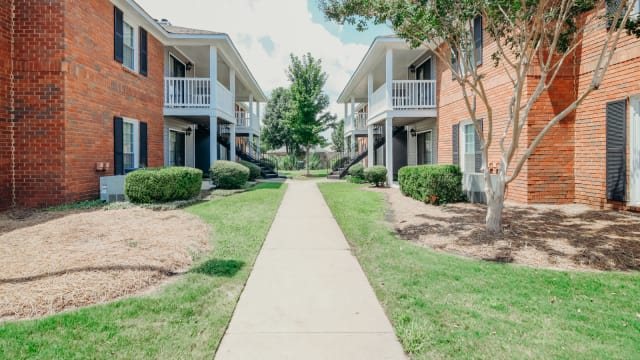 Exterior Walkway at Halcyon Park Apartments in Montgomery, Alabama