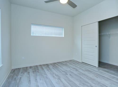 Bedroom with spacious closet at LARC at Burien in Burien, WA