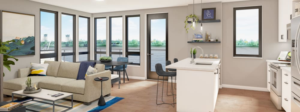Interior rendering of a kitchen and living room with view of the river at The Columbia at the Waterfront in Vancouver, Washington