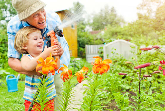 Resident and grand-child gardening at The Retreat at Lady's Island in Beaufort, South Carolina