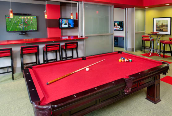 Red velvet billiard table in the clubhouse at Celsius in Charlotte, North Carolina