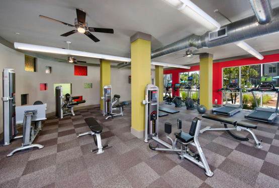 Well-equipped onsite fitness center at Perimeter Lofts in Charlotte, North Carolina