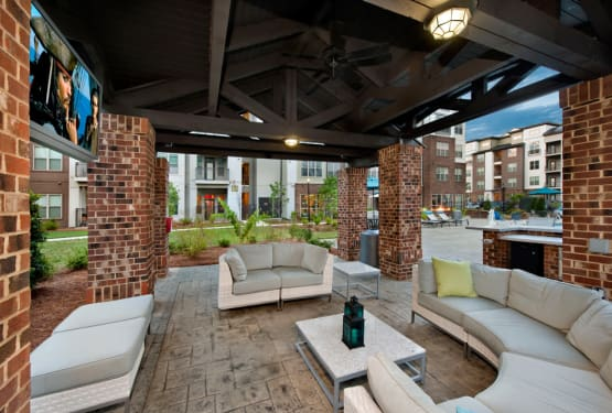 Covered outdoor cabana with comfortable seating at Celsius in Charlotte, North Carolina