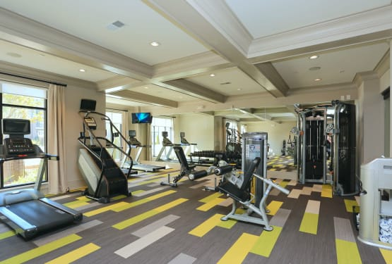 Well-equipped onsite fitness center at The Heights at Sugarloaf in Duluth, Georgia