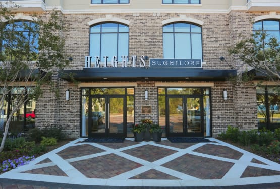 Exterior view of the entrance to our luxury community at The Heights at Sugarloaf in Duluth, Georgia