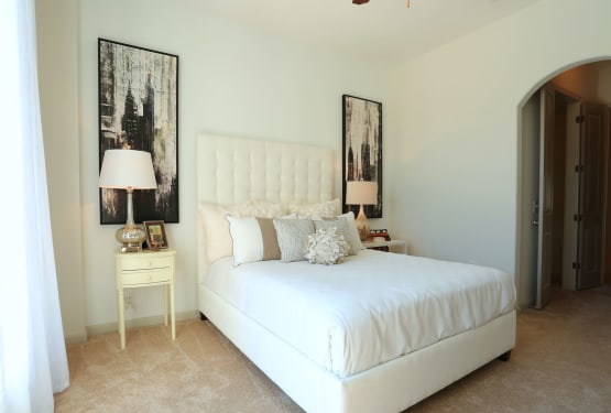 Ample natural light filling the bedroom of a model home at The Heights at Sugarloaf in Duluth, Georgia