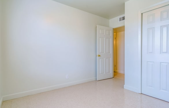 Spacious bedroom and closet in empty apartment home at Bossier East Apartments