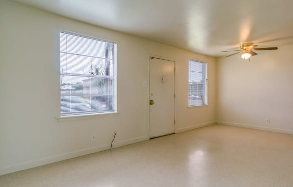 Interior view of empty apartment home at Bossier East Apartments showcasing plenty of natural light and open living space