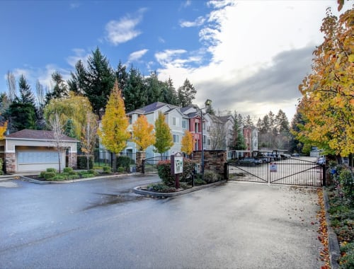 Well manicured landscape with a secure front-gate entrance at The Dakota Apartments in Lacey, Washington