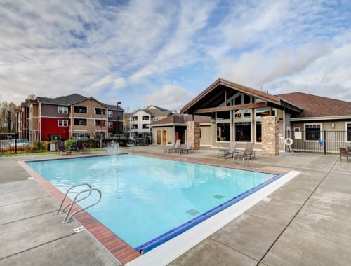 Swimming pool with a spacious sundeck at The Meadows in Tacoma, Washington