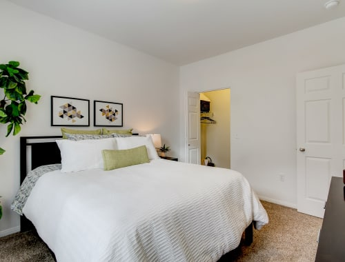 Bedroom with a walk-in closet at The Meadows in Tacoma, Washington