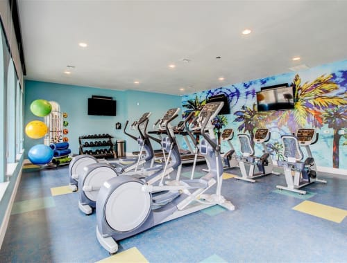Resident fitness center with elliptical and spin bikes at The Palms at Morada in Stockton, California