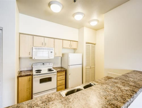 Beautiful kitchen with white appliances at Tierra Pointe in Casa Grande, Arizona