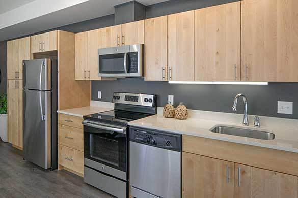 Beautiful kitchen with stainless-steel appliances at Montessa in Portland, Oregon