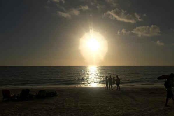 Stunning beach sunset near All Seasons Naples in Naples, Florida