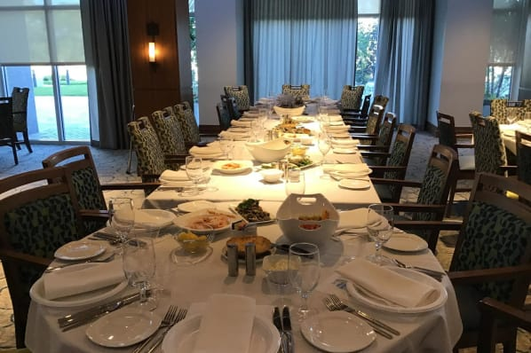 Beautifully set tables ready for dinner service at All Seasons Naples in Naples, Florida