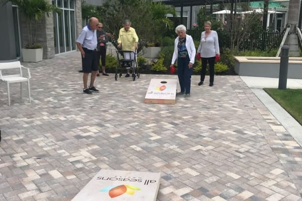 We have fun playing games at All Seasons Naples in Naples, Florida
