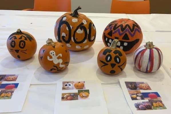 Creative Pumpkins Painted by Residents During a Festive Art Class