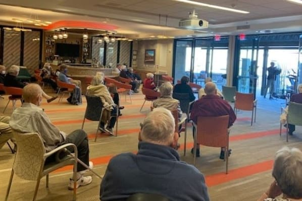 Residents Enjoying a Brass Quartet Musical Concert During Social Hour