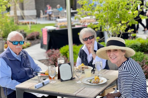 Residents Enjoying the Outdoors During a Grill Out