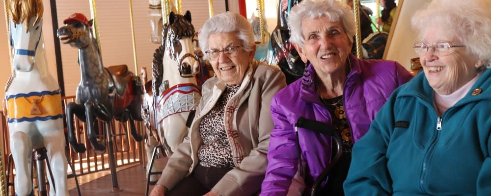 Residents engaged in carousel fun at The Springs at Butte in Butte, Montana