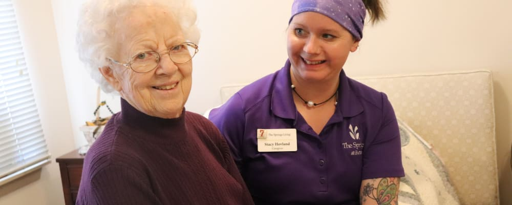 Resident  smiling with caregiver at The Springs at Butte in Butte, Montana