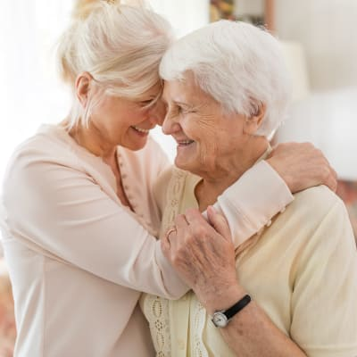 Woman hugging elderly mother