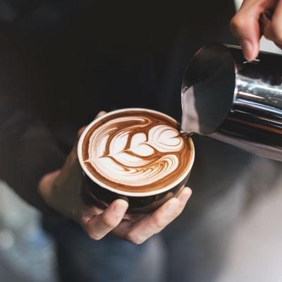 Barista pouring some beautiful latte art at a café near Terra Martinez in Martinez, California