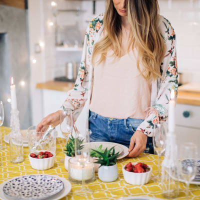 Resident preparing a fresh, delectable meal in her new home at Sofi Ventura in Ventura, California