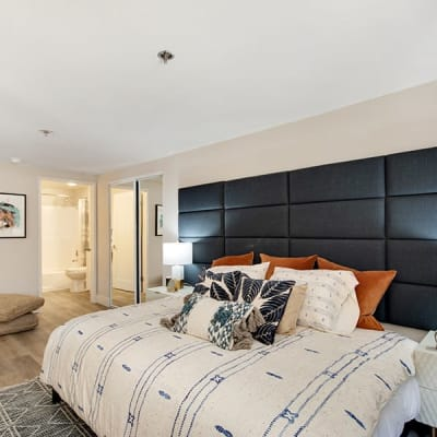 Comfortable decor in the bedroom area of a model studio apartment at Vue Los Feliz in Los Angeles, California