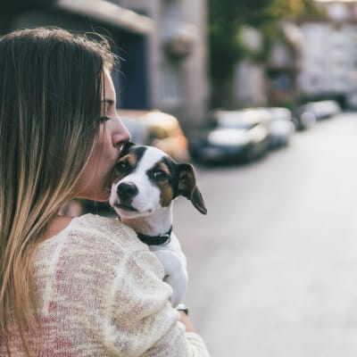 Resident hugging her puppy as they go for a walk in the neighborhood near Sofi Redwood Park in Redwood City, California
