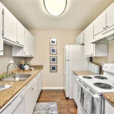 Light color scheme in the kitchen of a model home at Sofi Union City in Union City, California