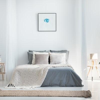 Minimalist decor in a model home's bedroom at Sofi Union City in Union City, California