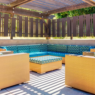 Outdoor lounge near the pool at Sofi Belmont Hills in Belmont, California