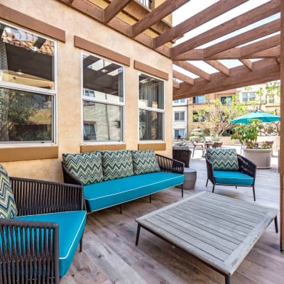 Luxurious outdoor lounge with a pergola overhead at Sofi at Topanga Canyon in Chatsworth, California