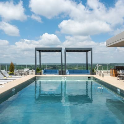 Sparkling, resort-style swimming pool with a poolside lounge at Two Twelve Clayton in Clayton, Missouri