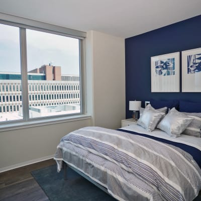 Bright, spacious bedroom with a view of the city at Two Twelve Clayton in Clayton, Missouri