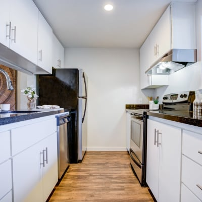 Modern kitchen with stainless-steel appliances in a model home at Haven Martinez in Martinez, California