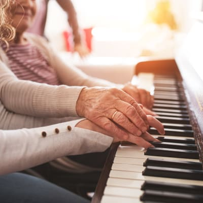 Resident giving a piano lesson at Westminster Memory Care in Aiken, South Carolina